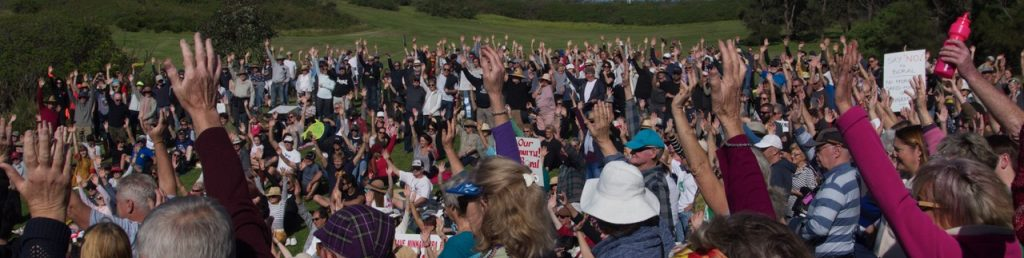 Over a thousand community members attend a protest at Minnamurra River