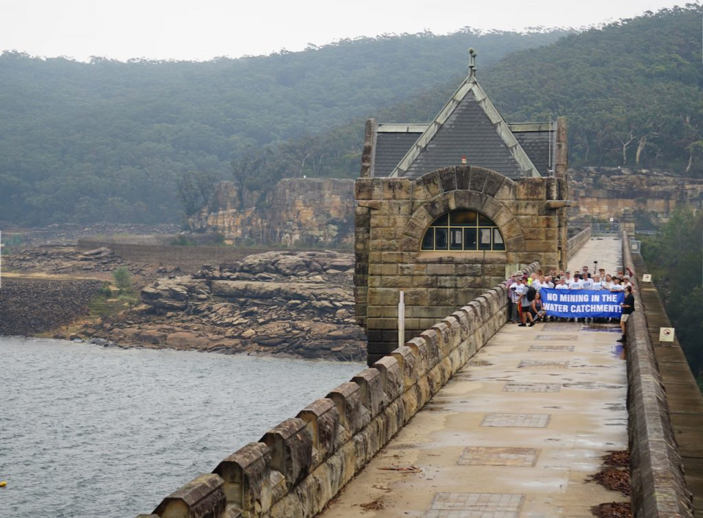 Protect Our Water Alliance protesters at Cataract Dam Wall. Photo credit: Protect Our Water Alliance.  It's barely a year since the Berejiklian government announced it would fast track the expansion of the desalination plant, with Minister Pavey stating that securing water supplies for the city was critical, noting dam levels dropping faster than seen before. Climate change is here and the times 'they are a changin', though perhaps not for some in the Department of Planning.