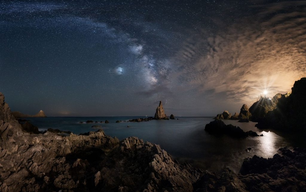 The beauty of the universe. Arrecife de las Sirenas, Spain Beautiful landscape with stars and ocean showing the beauty of the universe. Enjoy seeing the beauty of this world. There is no need to own the world.