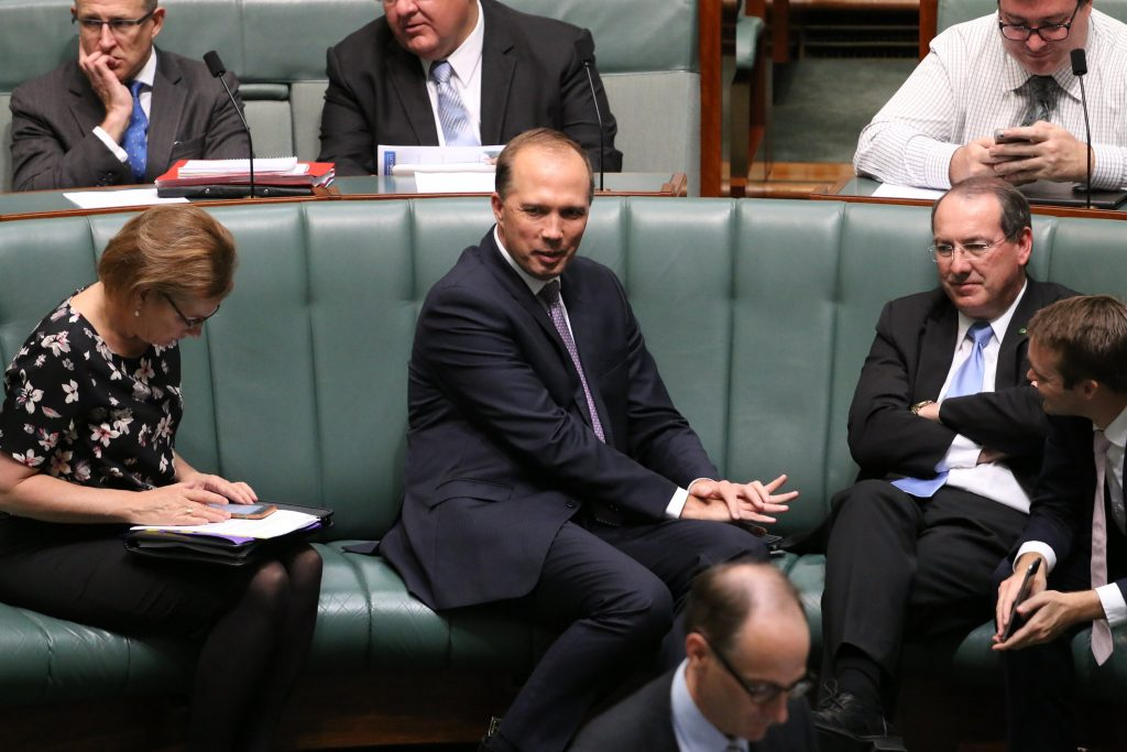A younger Peter Dutton sitting very comfortably in the male dominated environment of Parliament.
