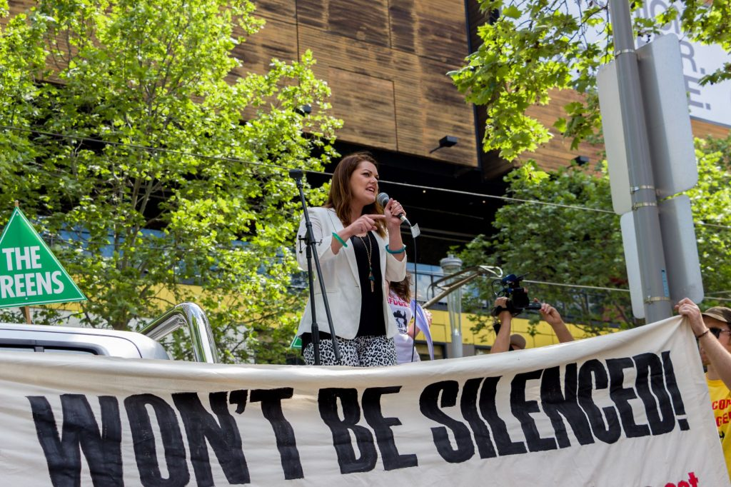 Greens Senator Sarah Hanson-Young speaking at a protest. She recently won a defamation case against a senior politician