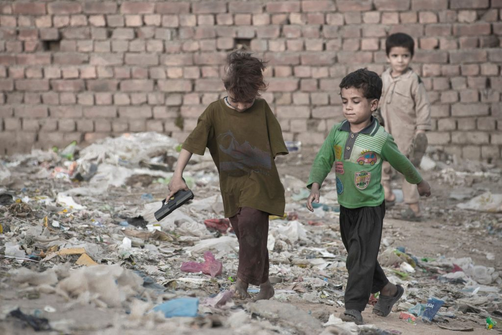 Afghani refugee children made homeless by war are playing in a slum in Lahore, Pakistan