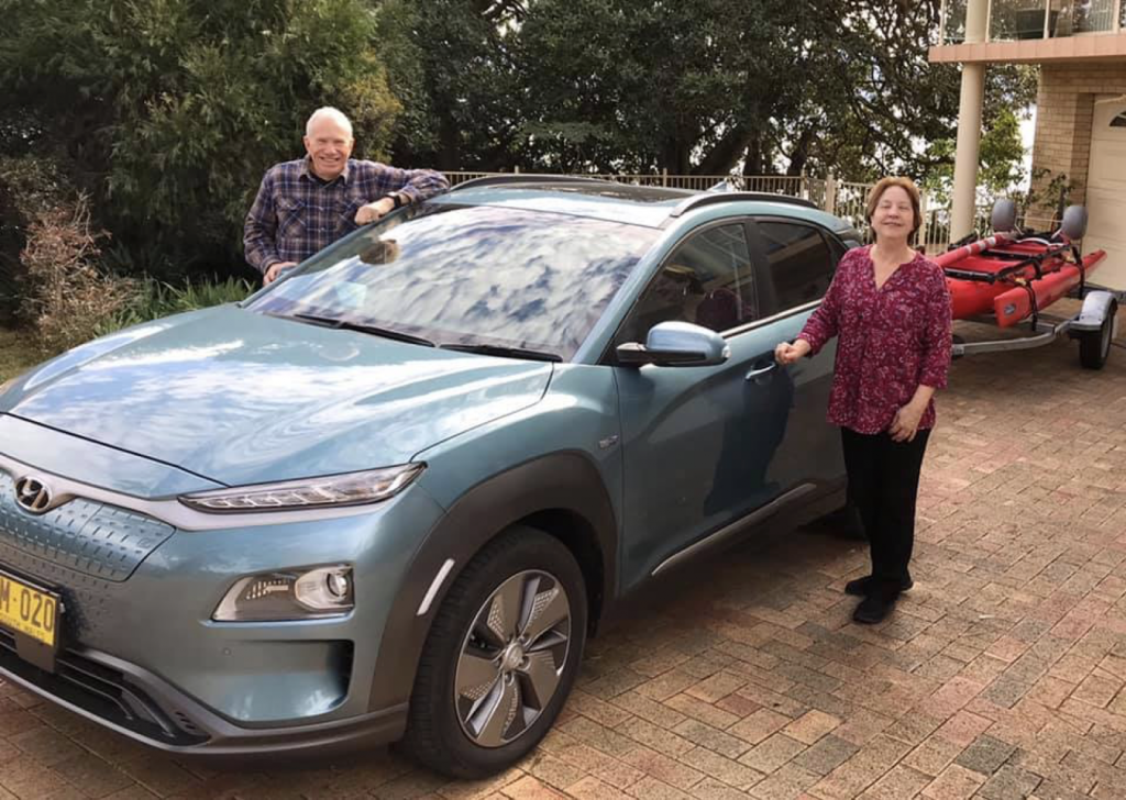 Tom and Evelyn Hunt with their electric Kona