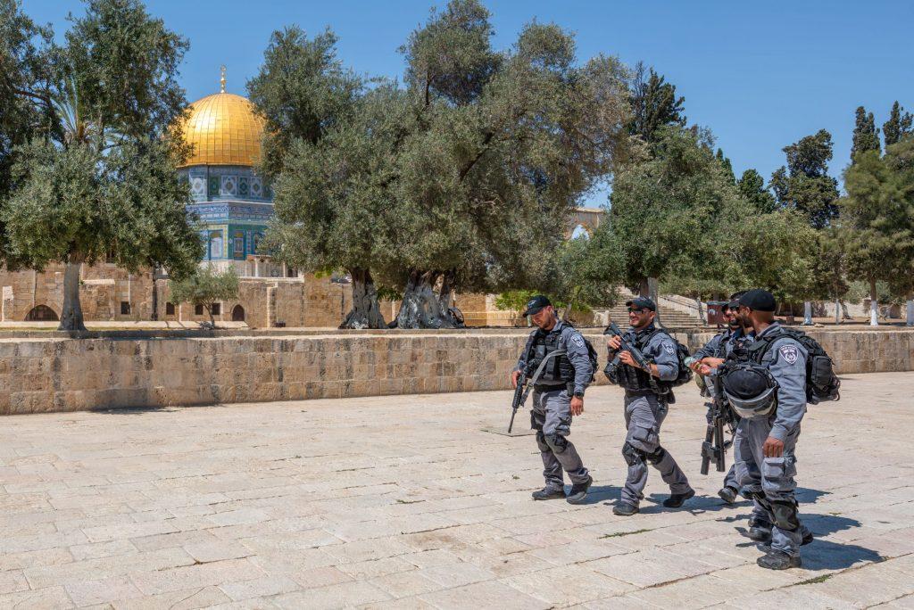 heavily armed Israeli security forces walk near Al Aqsa Mosque in East Jeruslam
