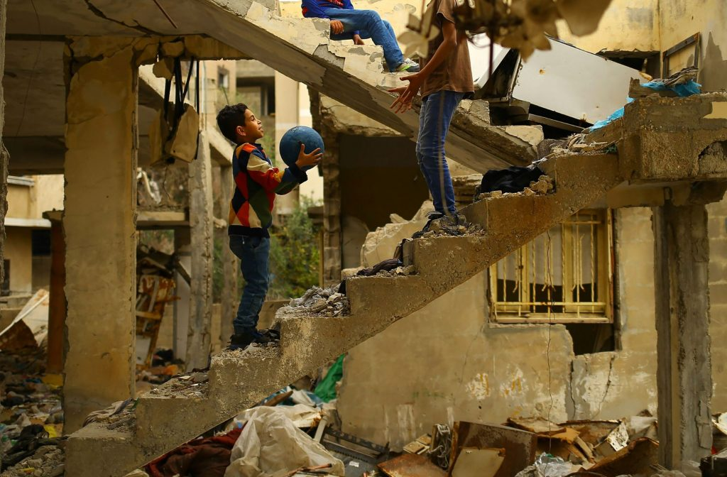 Palestinian children playing in the ruins of a building after the 50 day war in Gaza
