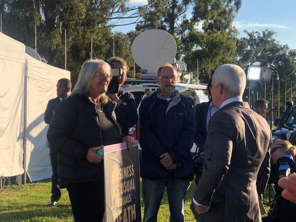 Senator Malcolm Roberts with Extinction Rebellion activists