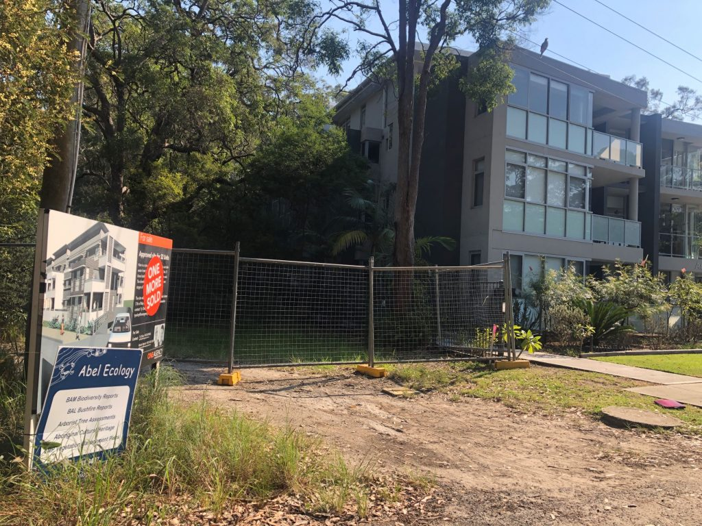 fence at front of new development site at Moona Moona Creek next to existing Aquamist apartment block
