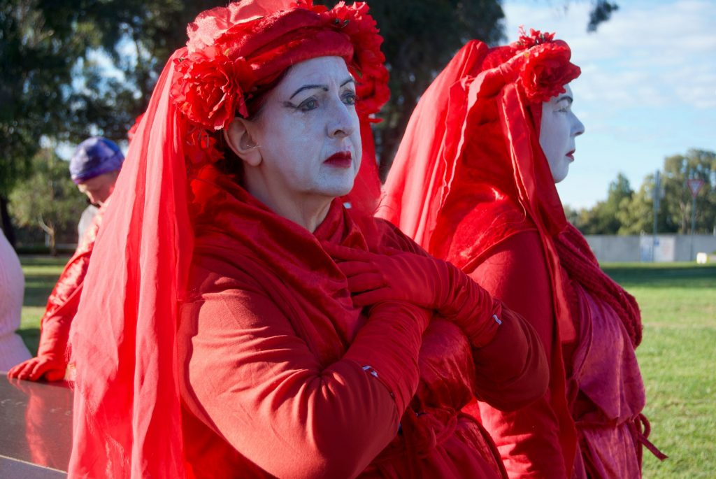 Two Extinction Rebellion activists in red
