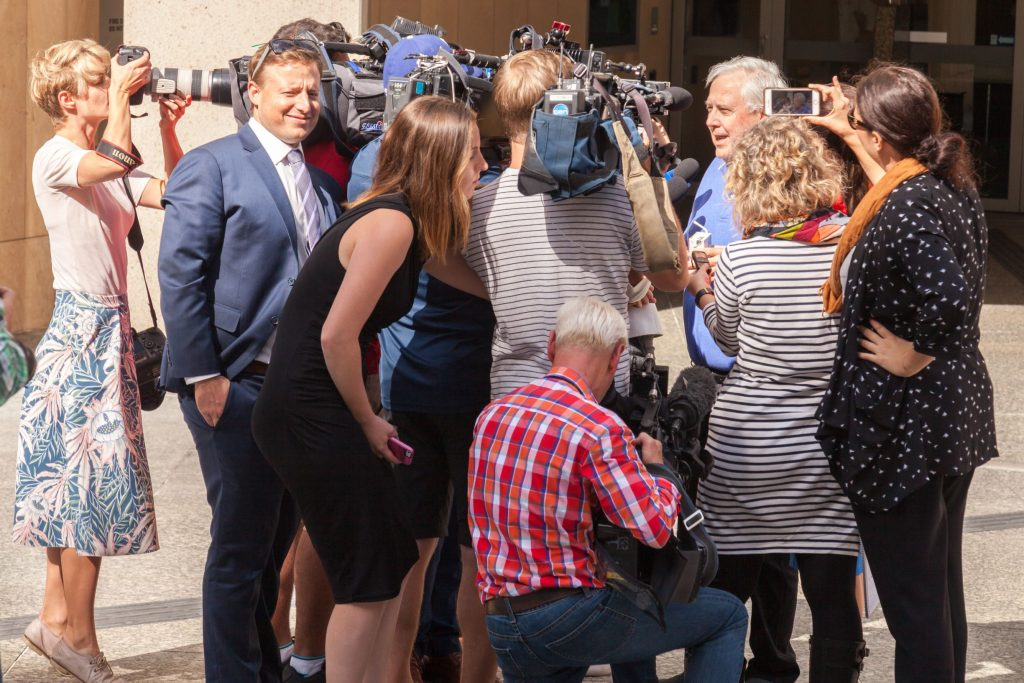 Clive Palmer being interviewed by media outside Commonwealth Law Courts in Brisbane in 2017