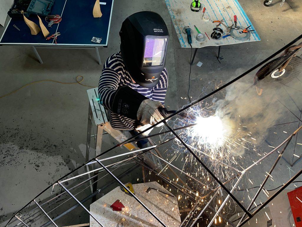 Dora Rognavaldsdottir welding in her art studio in Nowra @ Mad Cow Studio