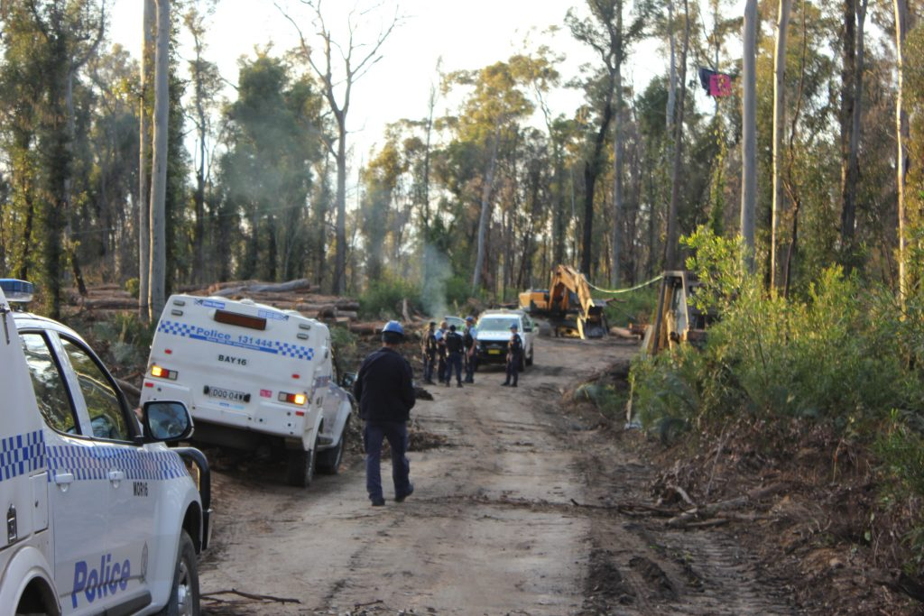 search and rescue police ending the protest against logging in Mogo State Forest