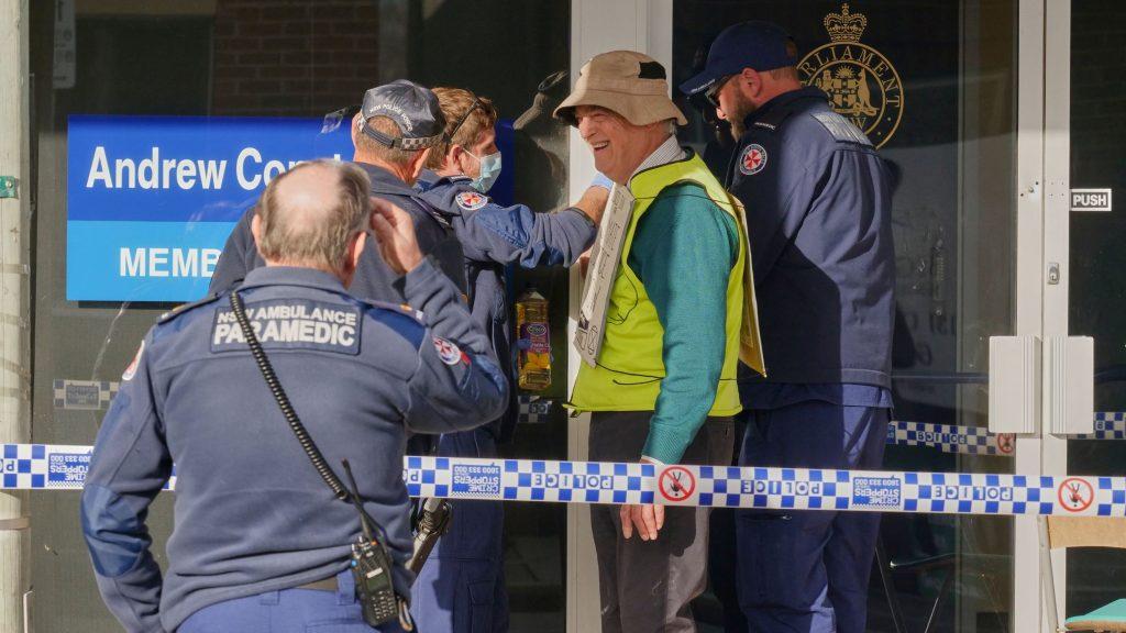 Bega Police un-gluing XR protester Andrew from office door