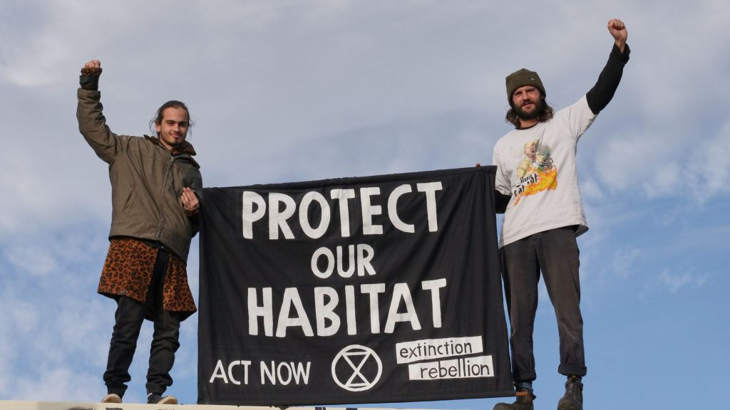 XR protesters Jarrad and Sergeio on the roof of Andrew Constance's office building demanding protection of habitat