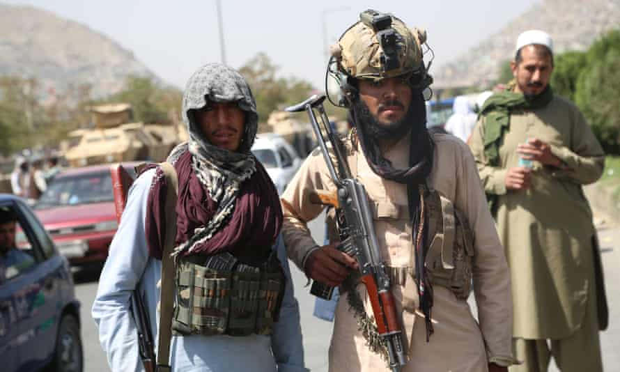 Taliban fighters in Kabul on their first day of rule in Afghanistan